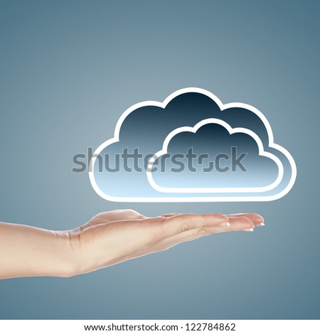 Hand with cloud computing symbol against colour background - stock photo