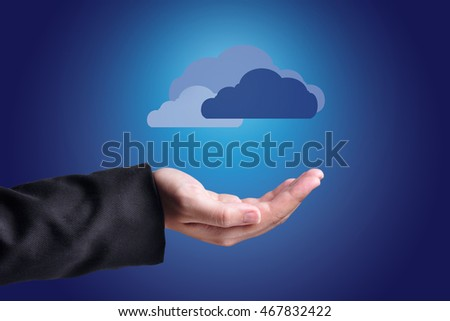 Hand with clouds over them. Cloud computing concept.