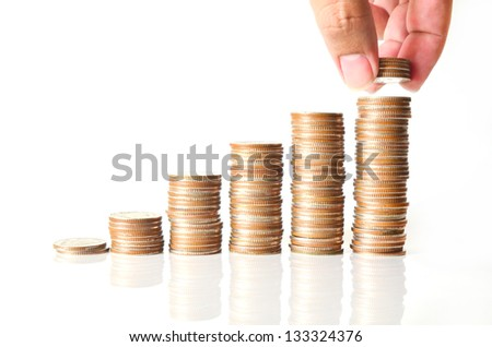 Hand with coin and money stairs isolated on white background