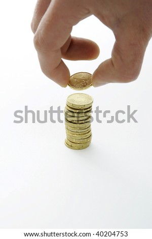 Hand with coin stack on white background