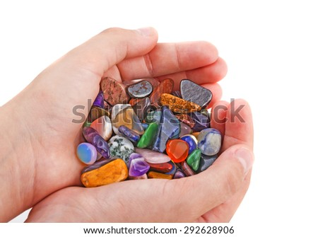 hand with collection of semiprecious natural stones - stock photo