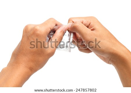Hand with condom. Safe sex concept.  - stock photo