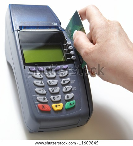 Hand with credit card swipe through terminal for sale - stock photo