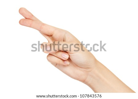 Hand with crossed fingers isolated on white - stock photo