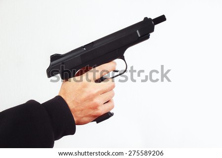 Hand with discharged semi-automatic handgun on a white background - stock photo