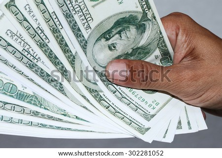 hand with dollar banknotes background. - stock photo