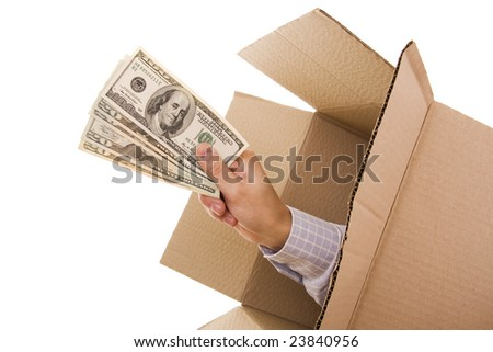 Hand with dollars inside a cardboard box