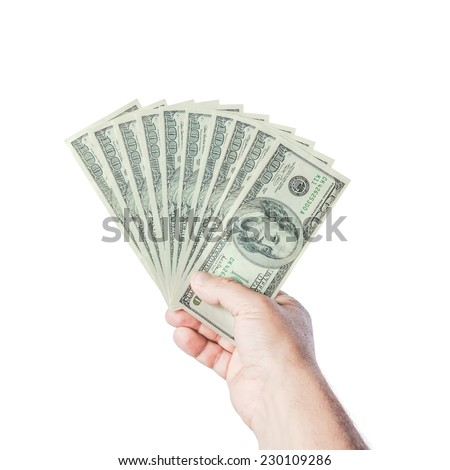 Hand with dollars isolated on a white background - stock photo