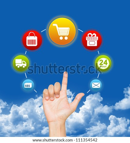 Hand With E-Commerce Icon Around For Internet and Online Shopping Concept in Blue Sky Background - stock photo