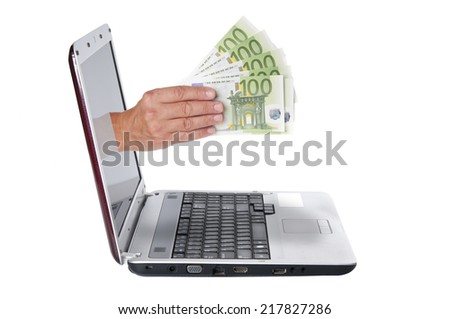 Hand with euro banknotes comes from the laptop screen  - stock photo