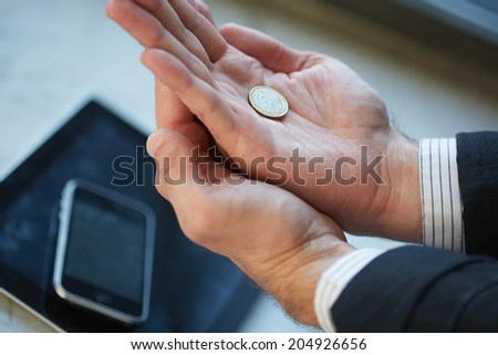 hand with euro coin - stock photo