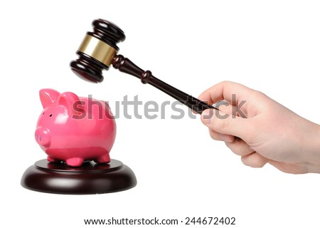 Hand with gavel beats on a piggy bank - stock photo