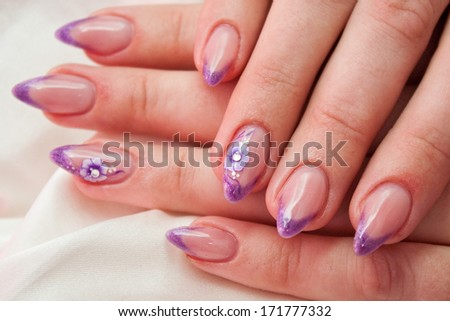 Hand with gel painted nails - stock photo