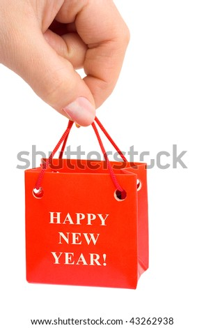 Hand with gift isolated on white background - stock photo