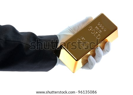 hand with glove holding a gold bar - stock photo