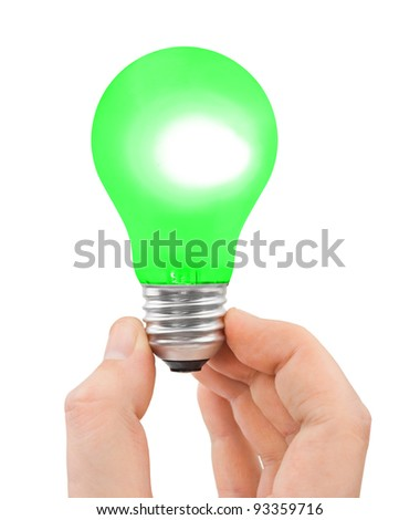 Hand with green bulb isolated on white background - stock photo