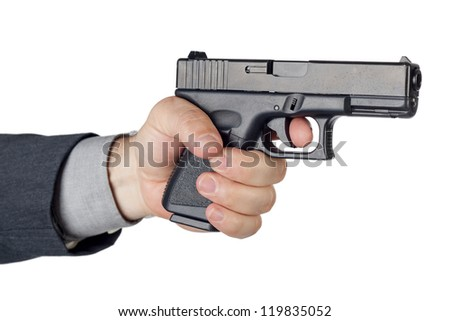 Hand with gun on white background - stock photo