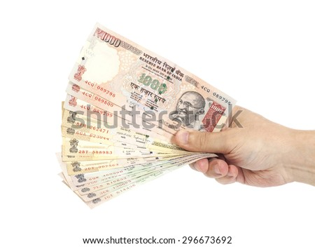 Hand with Indian thousand rupee notes isolated - stock photo