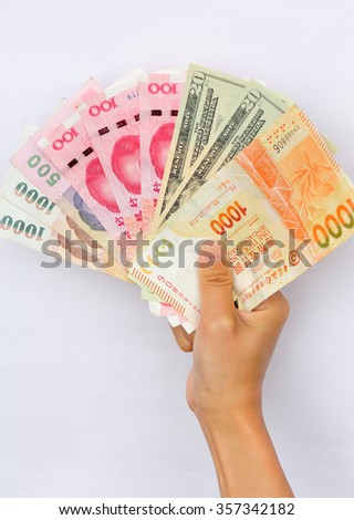 Hand with international cash