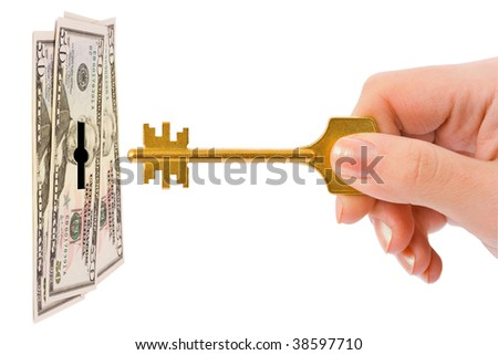 Hand with key and money isolated on white background - stock photo