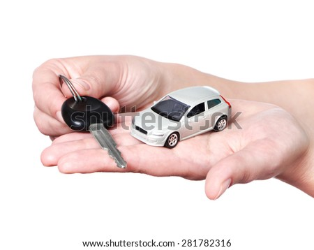Hand with keys and car on white background - stock photo