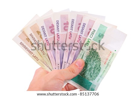 hand with latvian money
