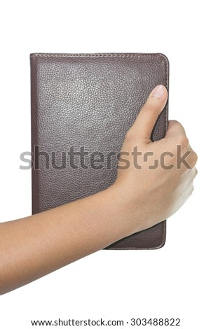 Hand with leather bag isolated on white background - stock photo