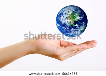 Hand with levitate world over white background, Isolated image - stock photo