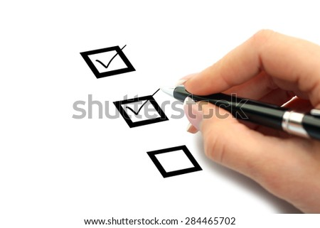 Hand with marker and check boxes isolated on white