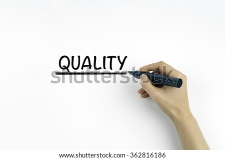 Hand with marker writing - Quality - stock photo