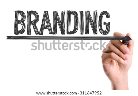 Hand with marker writing the word Branding - stock photo