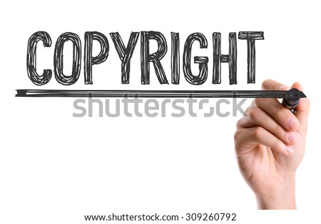 Hand with marker writing the word Copyright - stock photo