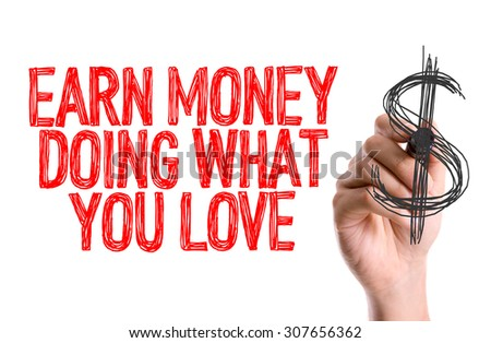 Hand with marker writing the word Earn Money Doing What You Love - stock photo