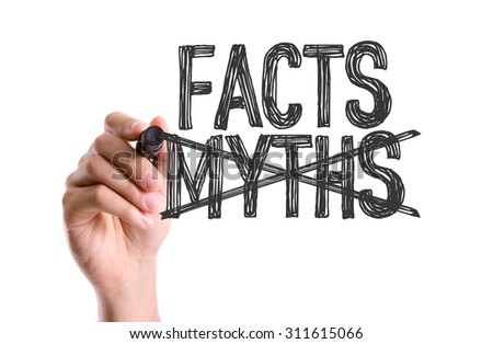Hand with marker writing the word Facts Myths - stock photo