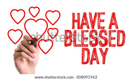 Hand with marker writing the word Have a Blessed Day - stock photo
