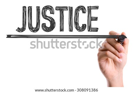 Hand with marker writing the word Justice - stock photo