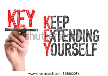 Hand with marker writing the word Keep Extending Yourself - stock photo