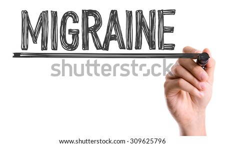 Hand with marker writing the word Migraine - stock photo