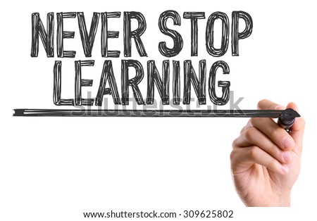 Hand with marker writing the word Never Stop Learning - stock photo