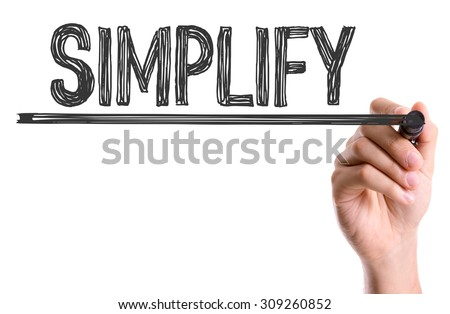 Hand with marker writing the word Simplify - stock photo