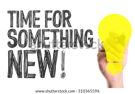 Hand with marker writing the word Time For Something New - stock photo