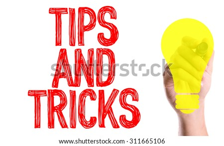 Hand with marker writing the word Tips and Tricks - stock photo