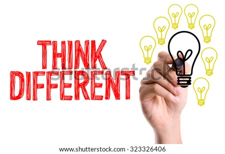 Hand with marker writing: Think Different - stock photo