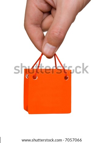 Hand with mini bag, isolated on white background - stock photo