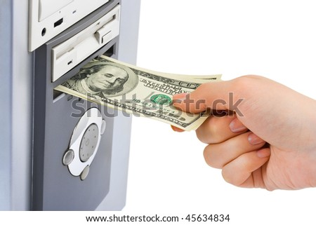 Hand with money and computer isolated on white background