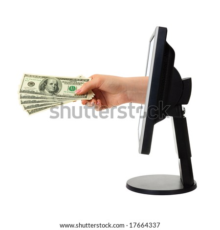Hand with money and computer monitor isolated on white background - stock photo