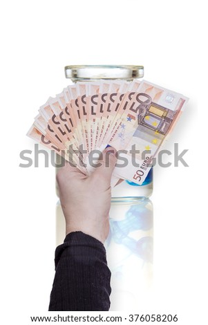 hand with money and variety of red bottles of medicine