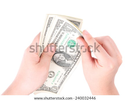 Hand with money isolated on a white background - stock photo