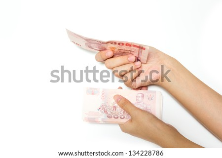 Hand with money on a white background - stock photo