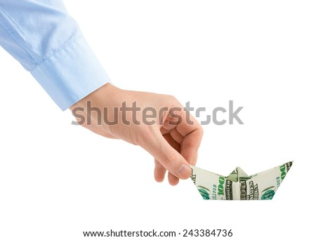 Hand with money ship isolated on white background - stock photo